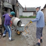 Ady and Martin mixing cement