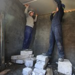 AJ and I attaching the last piece of plasterboard