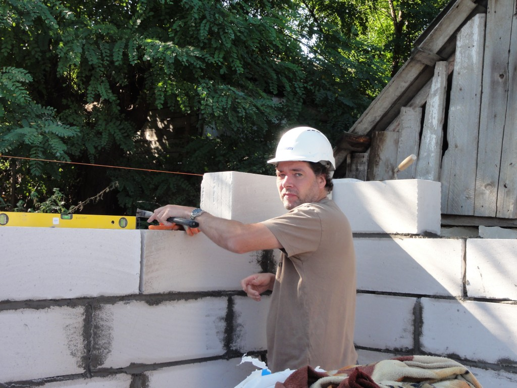 Stuart laying blocks in the second house