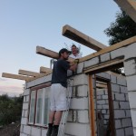 Richard and Sam working on the roof in the second house