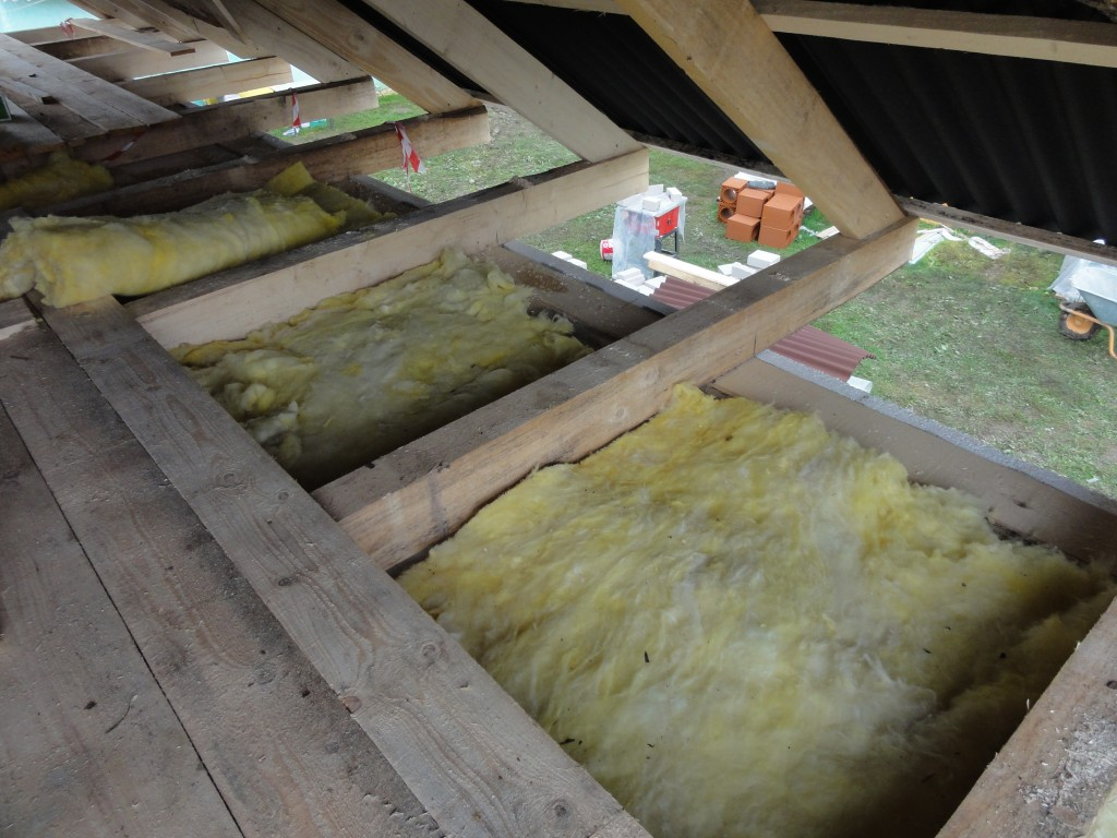 Insulation being installed in the loft