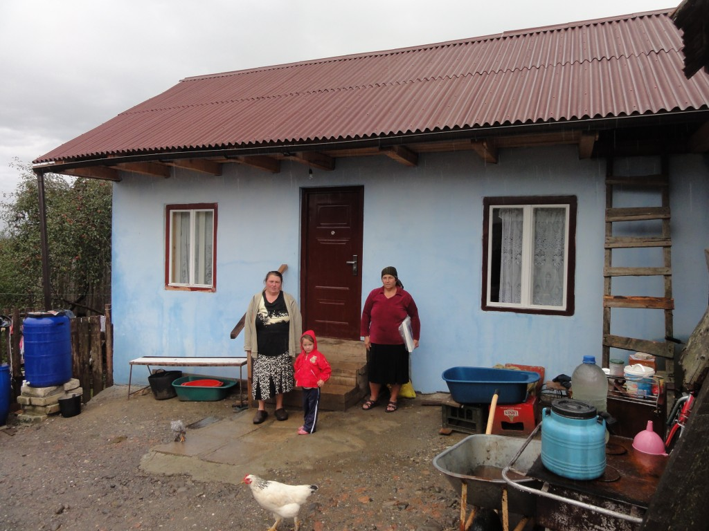 Family outside last year's house build