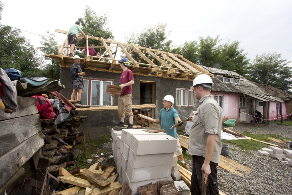 Moving a lot of tiles onto the roof of the smaller house